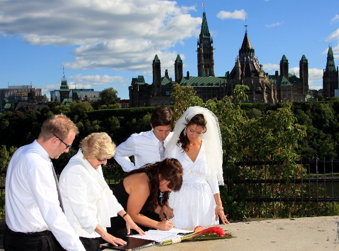 Lynne Langille performing  elopement ceremony at Nepean Point in Ottawa. Copyright 2010.